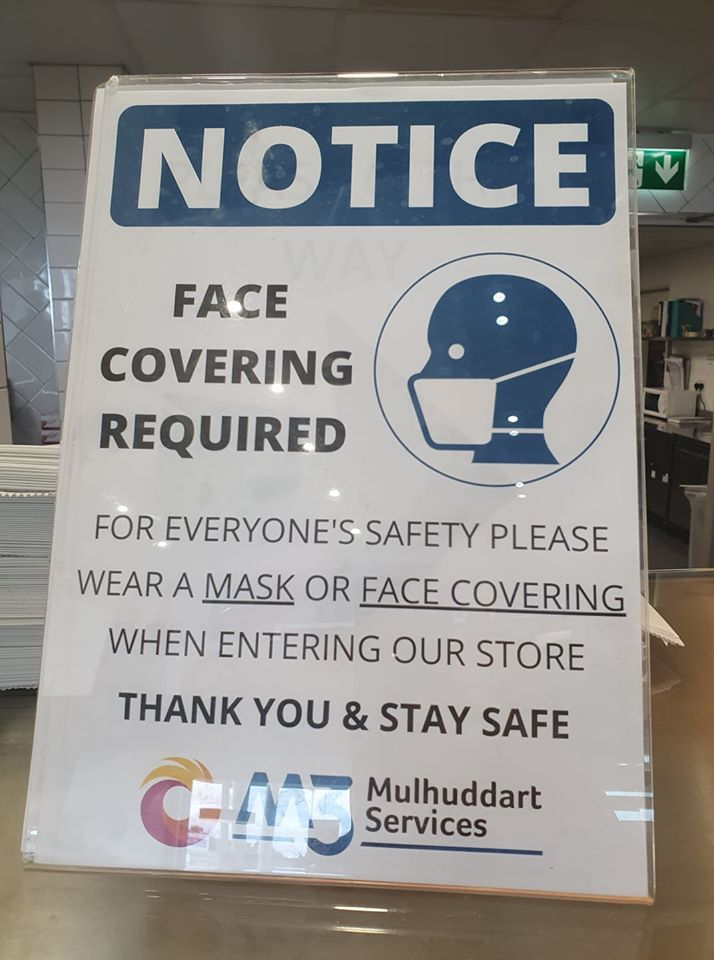 Signs to wear face masks in shops